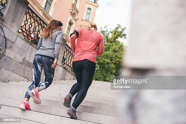Friends jogging in the city
