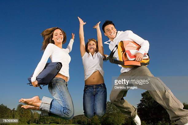 Friends jumping in the air.