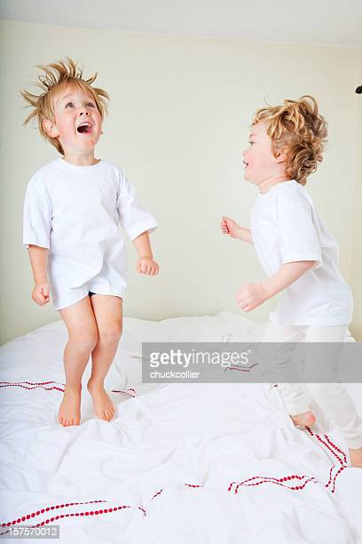 Friends jumping on the bed