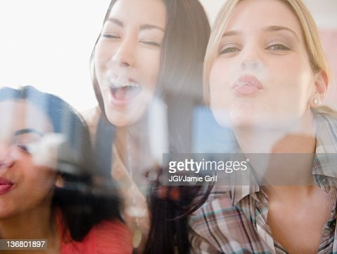 Friends kissing glass : Stock Photo
