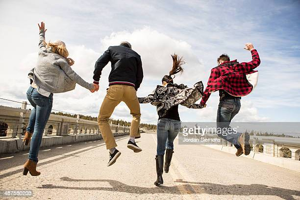 Friends leaping for fun.