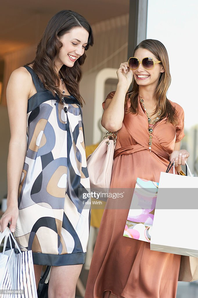Friends leaving boutique : Stock Photo