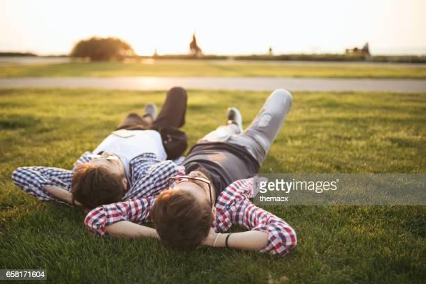 Friends lie down enjoying spring