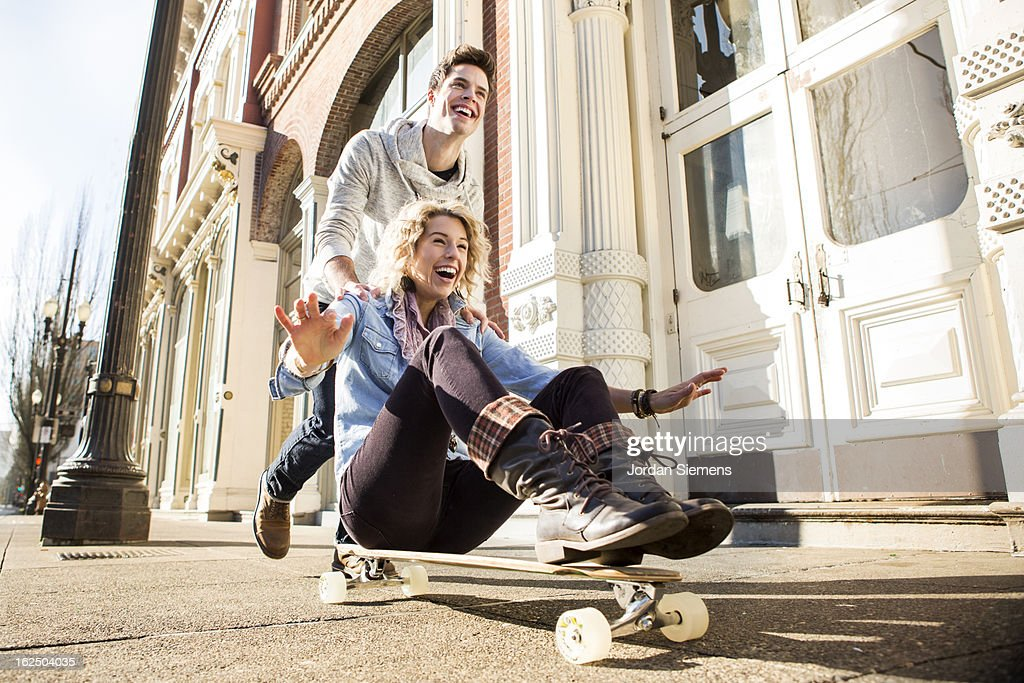 Friends longboarding in the city. : Stock Photo