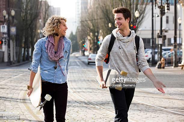 Friends longboarding in the city.