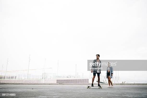 Friends longboarding in the street