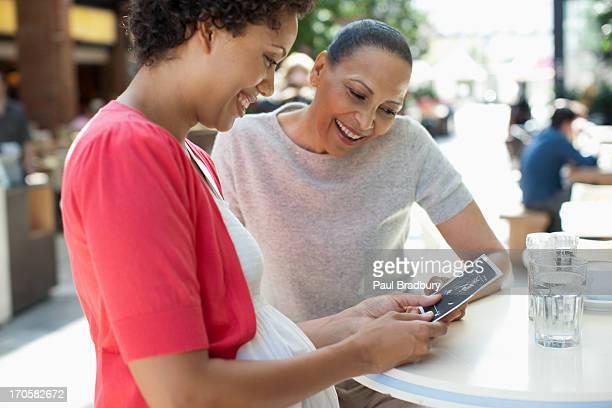 Friends looking at pregnancy sonogram image