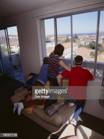 Friends looking out of window : Stock Photo