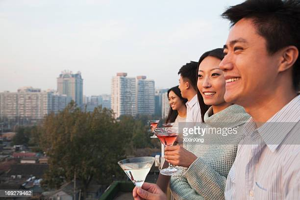 Friends Looking Out Over Cityscape