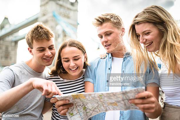 friends looking the map at tower bridge