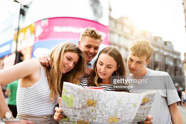 friends looking the map in piccadilly circus