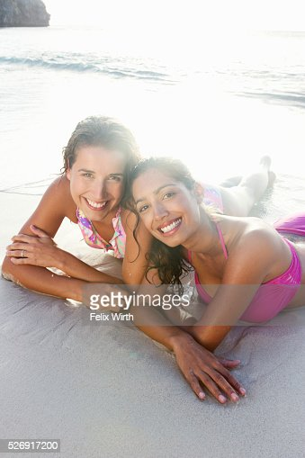 Friends lying on beach : Stock Photo