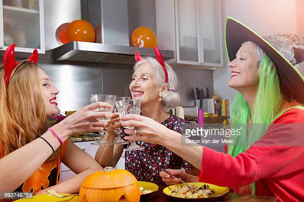 Friends make toast at Halloween dinnerparty