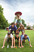 Friends making a human pyramid in the park