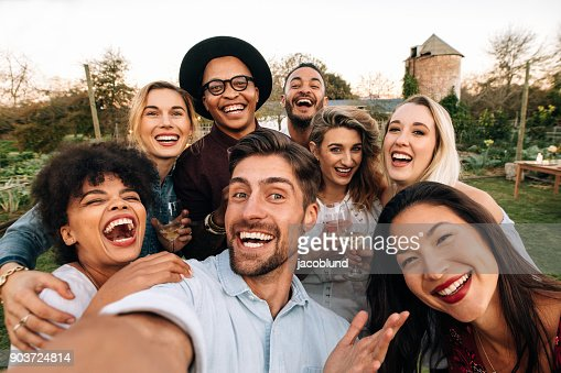 Friends making a selfie together at party : Foto stock