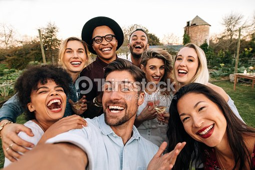 Friends making a selfie together at party : Stock Photo