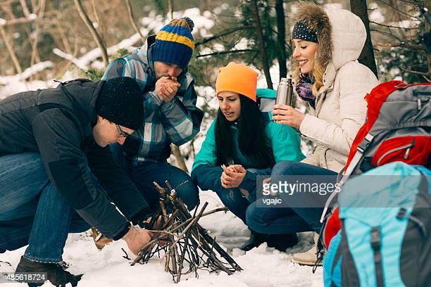 Friends Making Camp Fire.