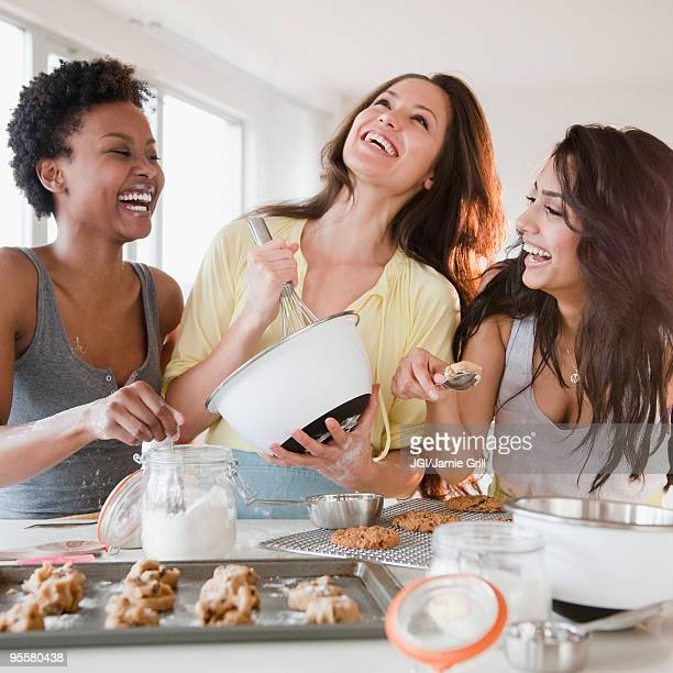 Friends making cookies together