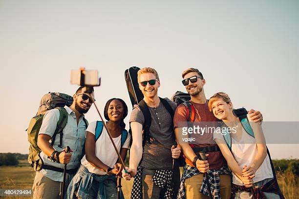 Friends Making Group Selfie At Hiking.