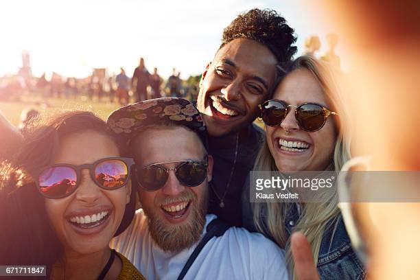 Friends making selfie at big festival