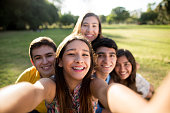 Close-up of teenage friends making a selfie with smartphone in park