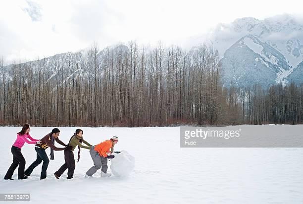 Friends Making Snowman