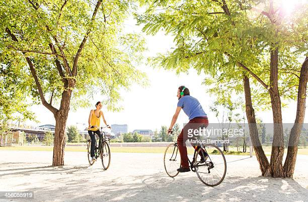 Friends meet in park on bicycles