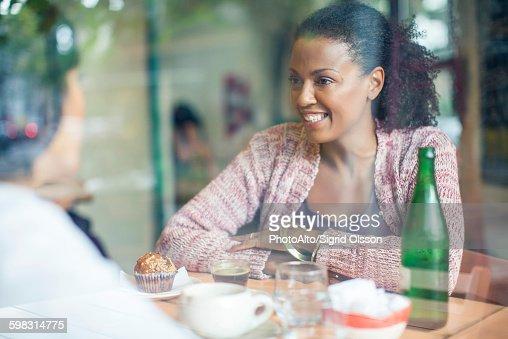 Friends meeting in coffee shop