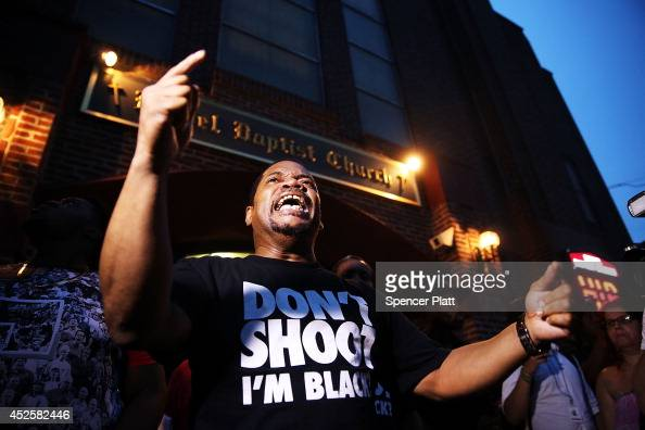 Friends of Eric protest after his funeral outside the Bethel Baptist Church on July 23 2014 in New York City New York Mayor Bill de Blasio announced...
