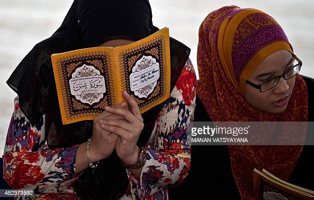 Friends of Nur Shazana Mohamed a crew member aboard Malaysia Airlines flight MH17 take part in a special remembrance prayer at a mosque in Putrajaya...