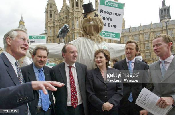Friends of the Earth anti GM protest left to right Michael Meacher David Drew Norman Baker Joan Ruddock Andrew George and Greg Barker at the palace...
