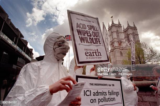 Friends of the Earth protesters demonstrating outside the ICI annual general meeting at the Queen Elizabeth II conference centre in London's...