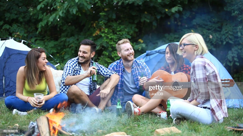 Friends on camping : Bildbanksbilder