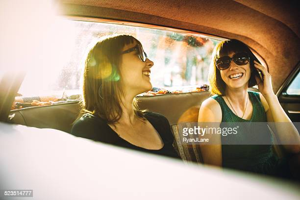 Friends on Phone in Classic Car