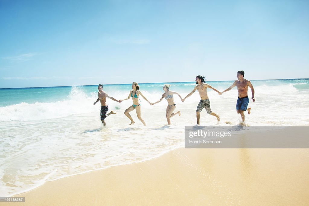 Friends on the beach : Stock Photo