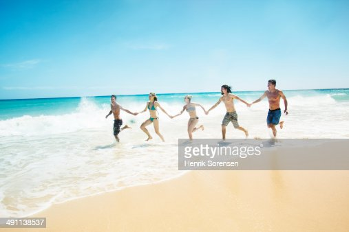 Friends on the beach : Stock Photo
