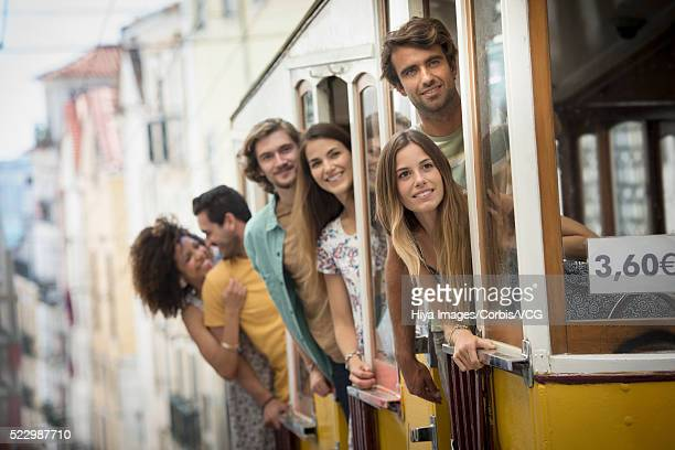 Friends on tram, Lisbon, Portugal