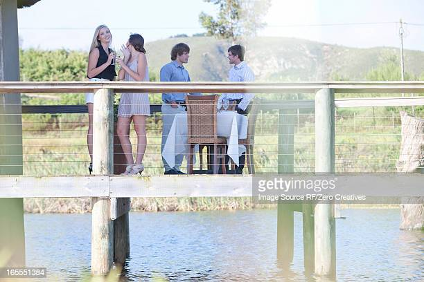 Friends on wooden deck outdoors