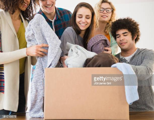Friends packing boxes together