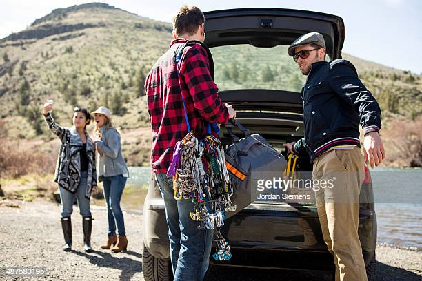 Friends packing up the car for a road trip.