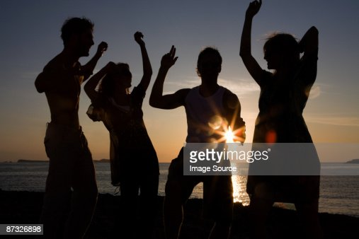 Friends partying on beach : Stock Photo
