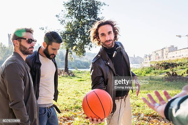 Friends passing around basket ball