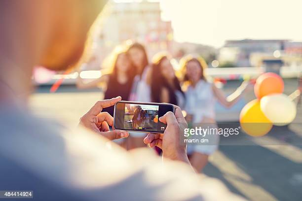 Friends photographing on the rooftop