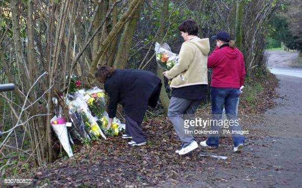 Friends place flowers at the scene of the accident in which four people died when the car in which they were travelling left the B4596 and plunged 30...