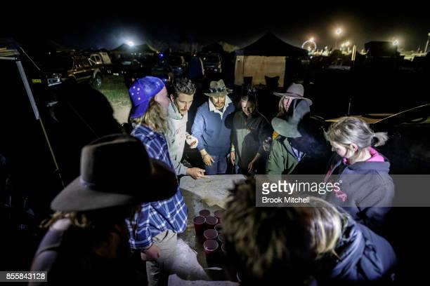 Friends play a drinking game on the final evening of the 2017 Deni Ute Muster on September 30 2017 in Deniliquin Australia The annual Deniliquin Ute...
