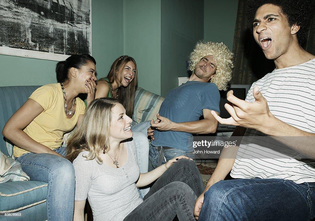Friends playing air guitar