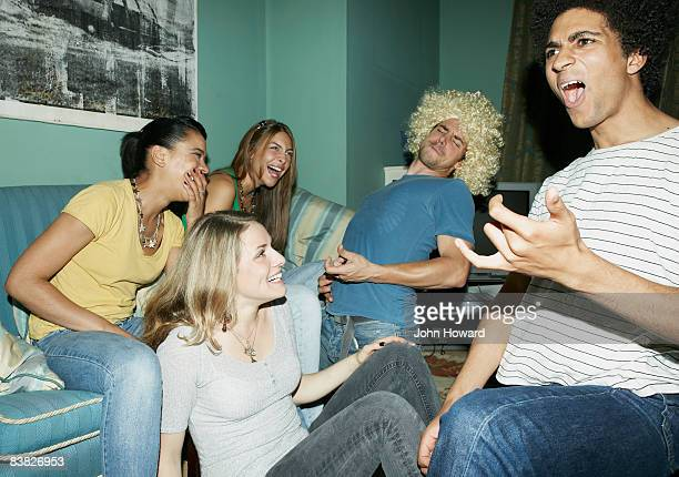 Friends playing air guitar