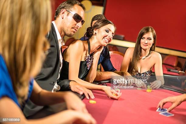 Friends playing at poker at Casino
