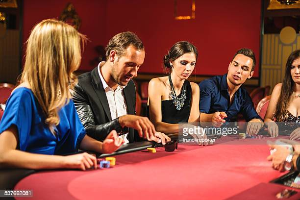 Friends playing at poker at Casino