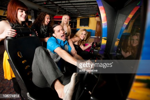 Friends Playing at Video Arcade